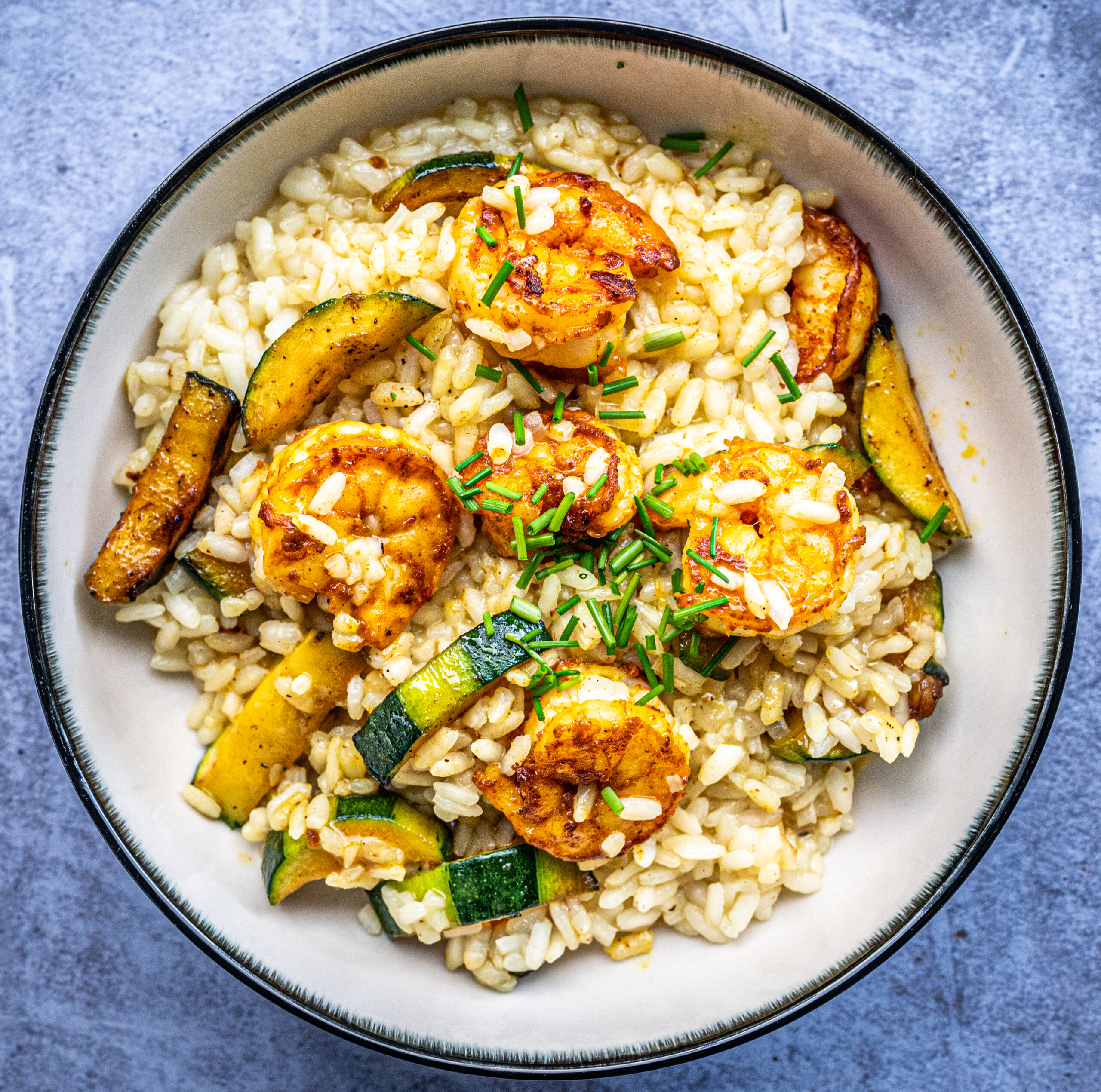 Risotto met scampi en courgette